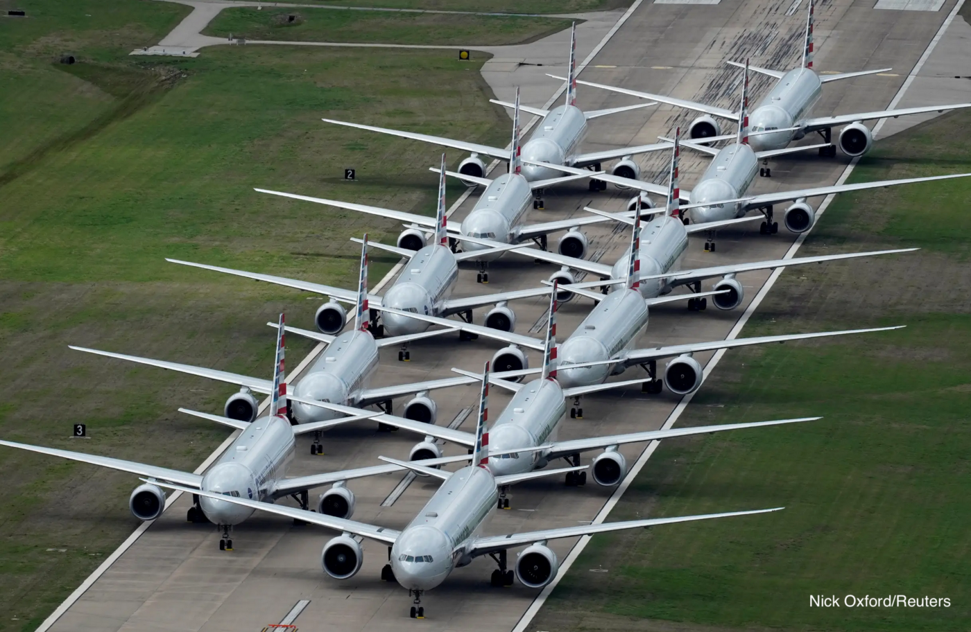 Parked airplanes by Nick Oxford/Reuters